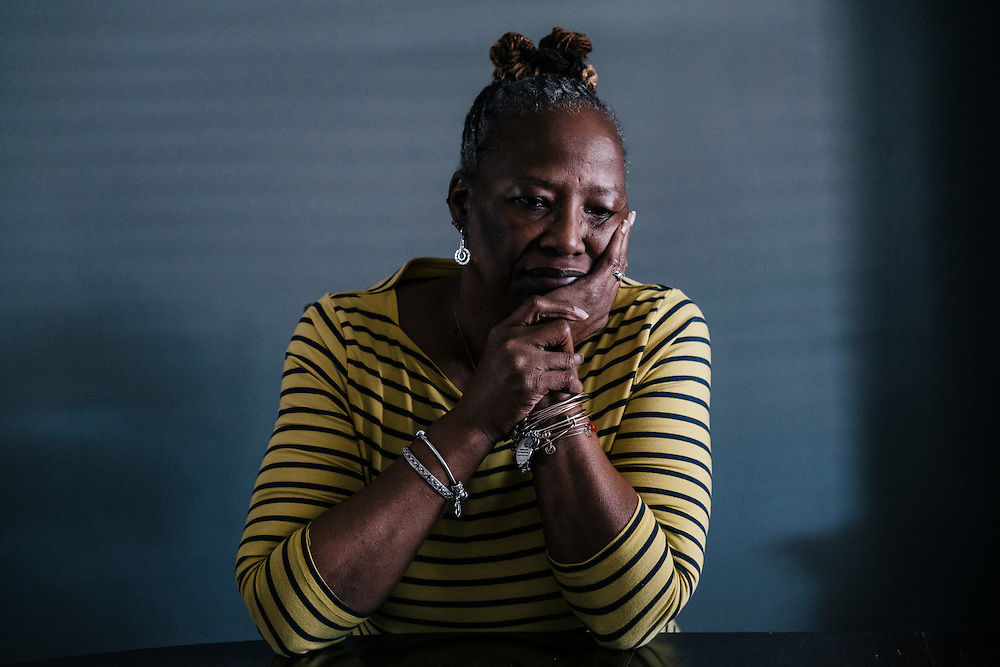 "Deborah Davis, mother of Harry Davis, at her dining room table in her home in Balitmore. Harry was fatally shot on Mother's Day while in their back yard in 2015. ""He was not only my son, but my best friend,"" Deborah said."