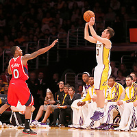 03 November 2013: Los Angeles Lakers point guard Steve Nash (10) takes a jumpshot over Atlanta Hawks point guard Jeff Teague (0) during the Los Angeles Lakers 105-103 victory over the Atlanta Hawks at the Staples Center, Los Angeles, California, USA.