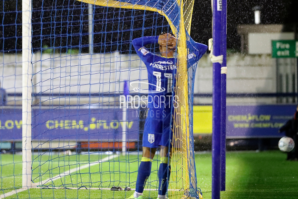 AFC Wimbledon attacker Harry Forrester (11) with head in hands whilst stood in the goal during the EFL Sky Bet League 1 match between AFC Wimbledon and Gillingham at the Cherry Red Records Stadium, Kingston, England on 12 September 2017. Photo by Matthew Redman.
