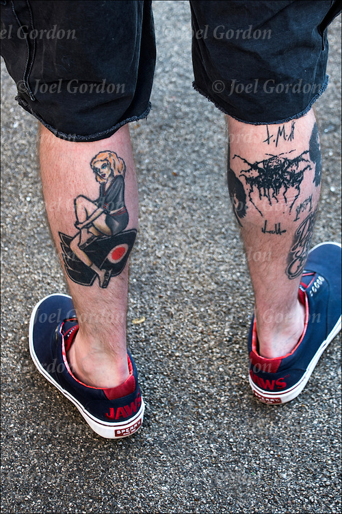 Tattoos on backs of both his legs<br /> <br /> Body art or tattoos has entered the mainstream it is no longer considered a weird kind of subculture.<br /> <br /> &quot;According to a 2006 Pew survey, 40% of Americans between the ages of 26 and 40 have been tattooed&quot;.