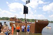 Milk carton pirate boat at finish of race on Lake Calhoun at Thomas Beach. Aquatennial Beach Bash Minneapolis Minnesota USA