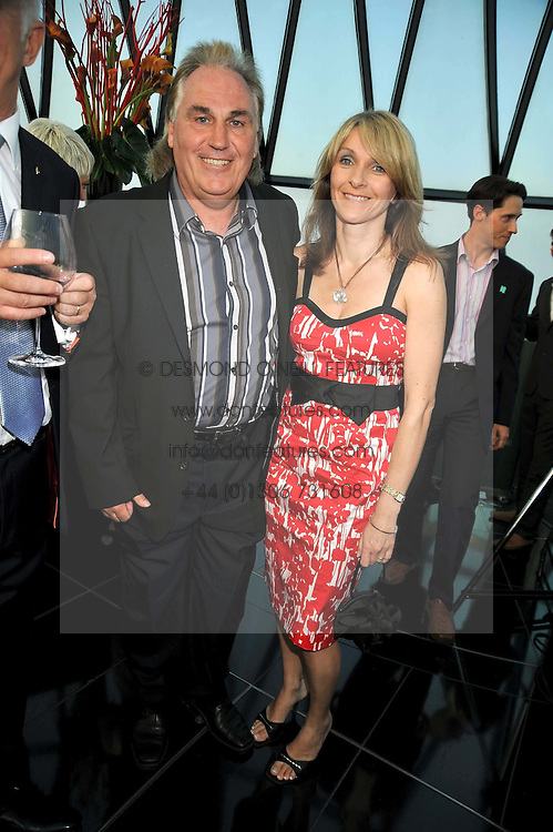 Football manager GERRY FRANCIS and his wife JULIE at the Variety Club gala evening held at The Gherkin, St.Mary Axe, City of London on 2nd July 2009.
