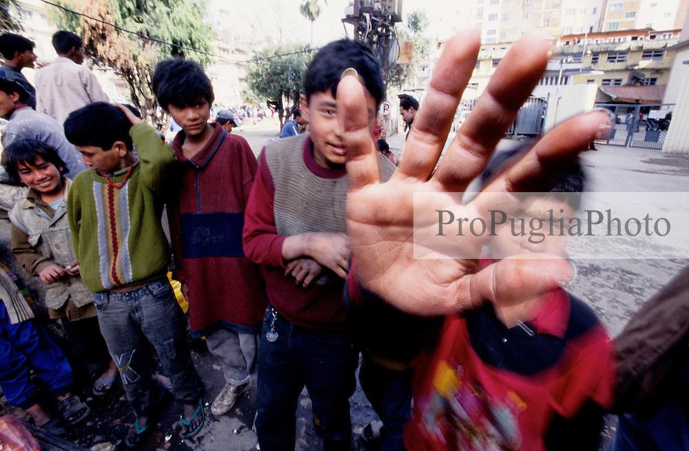 Kathmandu, 17 February 2005. Street childreen after breakfast