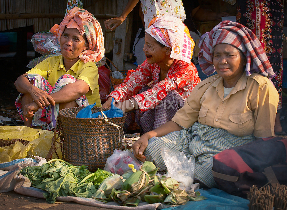 Old women set up shop at the Warloka market, Flores