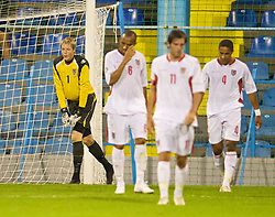 PODGORICA, MONTENEGRO - Wednesday, August 12, 2009: Wales' goalkeeper Wayne Hennessey looks dejected after Montenegro score the second goal during an international friendly match at the Gradski Stadion. (Photo by David Rawcliffe/Propaganda)