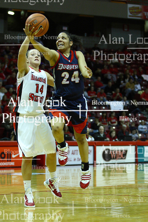 24 March 2011: Vanessa Abel steps around Amanda Clifton for a quick layup  during a WNIT (Women's National Invitational Tournament Women's basketball sweet 16 game between the Duquesne Dukes and the Illinois State Redbirds at Redbird Arena in Normal Illinois.
