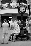 Infrared (IR) image - Keeneland Race Track is a beautiful facility.  I lived about three miles away and visited the track regularly with my IR modified and regular cameras.  This scene is typical of how it looked on a 'slow' racing afternoon between heats.  People dress up for the spectacle of it yet are often absorbed in their own world.  On a busy day people are packed so tight that there is no room to make photos.  This image was made on a cool week day afternoon.