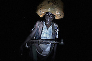 An FDLR (Forces Démocratiques de Libération du Rwanda) soldier treks through the jungle with supplies, in North Kivu, DRC, on Saturday, March. 15, 2008..The FDLR comprises Hutu extremists who fled Rwanda after their involvement in the 1994 genocide, as well as Hutu members of the former Rwandan army and a mix of displaced Rwandan Hutus. Numbering approximately 10,000, they have lived in the jungles of DRC for the past 14 years and in that time have resisted repeated calls for disarmament and repatriation..