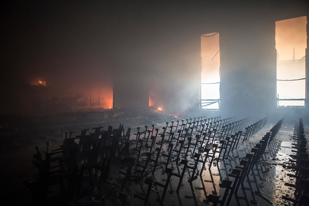 KIEV, UKRAINE - FEBRUARY 19: An auditorium inside the Trade Unions Building, which has served as the de facto headquarters for the anti-government protest movement, is filled with smoke and flames as the building burns on February 19, 2014 in Kiev, Ukraine. After several weeks of calm, violence has again flared between police and anti-government protesters, who are calling for the ouster of President Viktor Yanukovych over corruption and an abandoned trade agreement with the European Union. (Photo by Brendan Hoffman/Getty Images) *** Local Caption ***