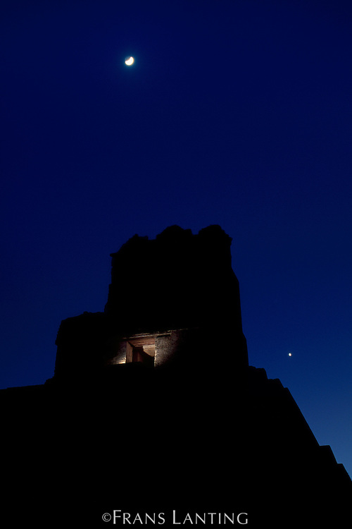 Moon and Venus over Mayan temple, Tikal National Park, Guatemala