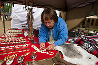Joanne Blanchette-Sulesky of Mohawk and Abenaki descent makes traditional wares at her booth during the LIHA Pow Wow in Sanbornton.  (Karen Bobotas/for the Laconia Daily Sun)