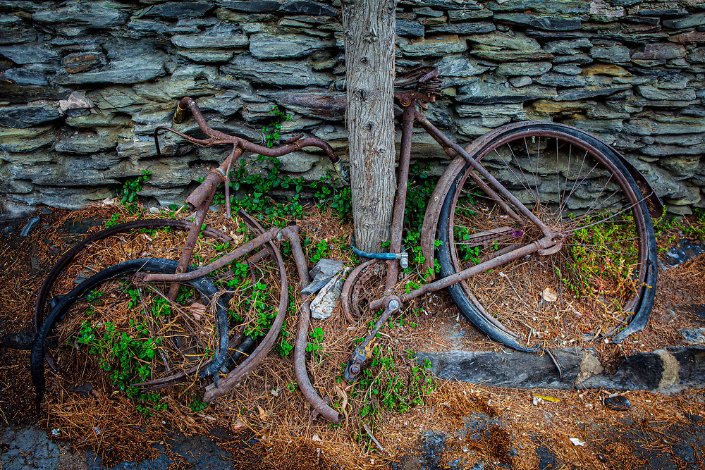 Abandonded bicycle outside Dali's house, Cala de Portlligat, Cadaques, Catalonia, Spain