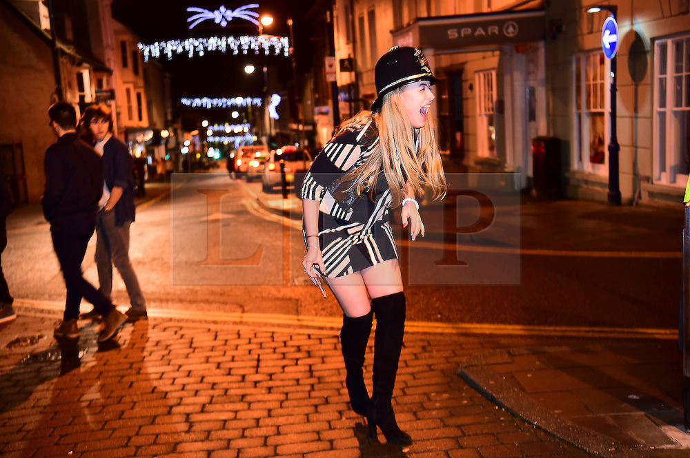 © London News Pictures. 01/01/2017. Aberystwyth, UK. A young woman wears a policeman's hat while out celebrating the 2017 New Year in Aberystwyth, Wales, UK on January 01, 2017. Photo credit: Keith Morris/LNP