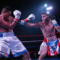 Josue Vargas of Puerto Rico (R) fights Carlos Winton Velasquez of Nicaragua during the Puerto Rico vs The World boxing event at Orlando Live Events Center on Friday, March 24, 2017 in Casselberry, Florida.  (Alex Menendez via AP)