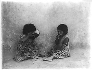 Native American Hopi children eating a melon, c1903.  Photograph by Edward Curtis (1868-1952).