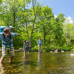 Skipping rocks on the Pleasant River in Maine's 100 Mile WIlderness. Appalachian Trail.