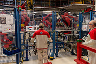 CASSINO, ITALY - NOVEMBER 24: Employee control the robot in the Body Shop where they assemble the Alfa Romeo Giulia in the Cassino Assembly Plant FCA Group. This is the most highly-automated area of the plant with nearly 1300 robots installed on November 24, 2016 in Cassino, Italy.