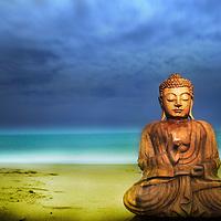 Buddha on a beach with blue summer sky