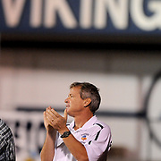 Hoggard Coach Scott Braswell applauds a play against Lumberton Friday September 19, 2014. (Jason A. Frizzelle)
