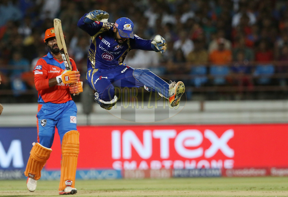 Parthiv Patel of the Mumbai Indians celebrates the wicket of  Dinesh Karthik of the Gujarat Lions during match 35 of the Vivo 2017 Indian Premier League between the Gujarat Lions and the Mumbai Indians  held at the Saurashtra Cricket Association Stadium in Rajkot, India on the 29th April 2017<br /> <br /> Photo by Vipin Pawar - Sportzpics - IPL