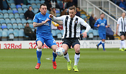 Lee Tomlin of Peterborough United in action with Dean Parrett of Gillingham - Mandatory by-line: Joe Dent/JMP - 06/04/2019 - FOOTBALL - ABAX Stadium - Peterborough, England - Peterborough United v Gillingham - Sky Bet League One