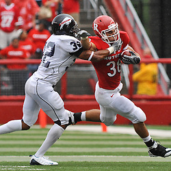 Sep 12, 2009; Piscataway, NJ, USA; Rutgers running back Joe Martinek (38) stiff-arms Howard cornerback Martin Corniffe (32) during the first half of Rutgers' 45-7 victory over Howard in NCAA College Football at Rutgers Stadium.