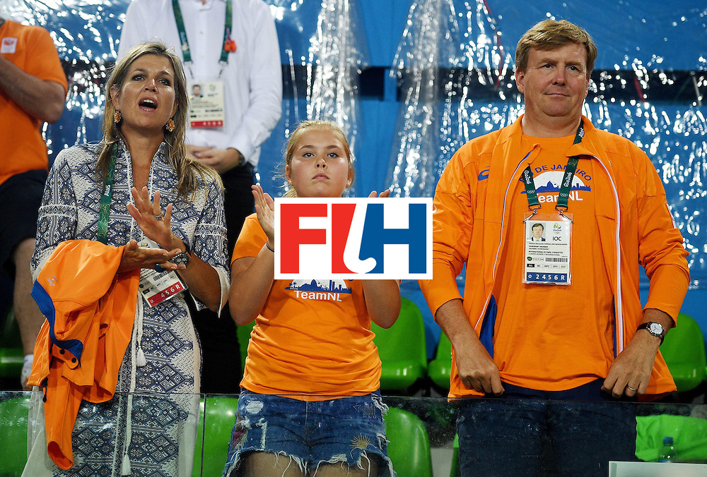 Dutch king Willem-Alexander (R), his wife Queen Maxima and their daughter attend the women's field hockey medals ceremony of the Rio 2016 Olympics Games at the Olympic Hockey Centre in Rio de Janeiro on August 19, 2016. / AFP / MANAN VATSYAYANA        (Photo credit should read MANAN VATSYAYANA/AFP/Getty Images)