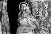 Roma - Romanian Gypsies - Roma mother and child, Galgaul, Transylvania. August 1996
