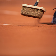PARIS, FRANCE May 27.  The clay court is cleaned between sets on Court Philippe-Chatrier in the Men's Singles first round match at the 2019 French Open Tennis Tournament at Roland Garros on May 27th 2019 in Paris, France. (Photo by Tim Clayton/Corbis via Getty Images)
