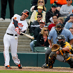 Mar 1, 2013; Sarasota, FL, USA; Baltimore Orioles catcher Matt Wieters (32) hits a single scoring Adam Jones during the bottom of the fifth inning of a spring training game against the Pittsburgh Pirates at Ed Smith Stadium. Mandatory Credit: Derick E. Hingle-USA TODAY Sports