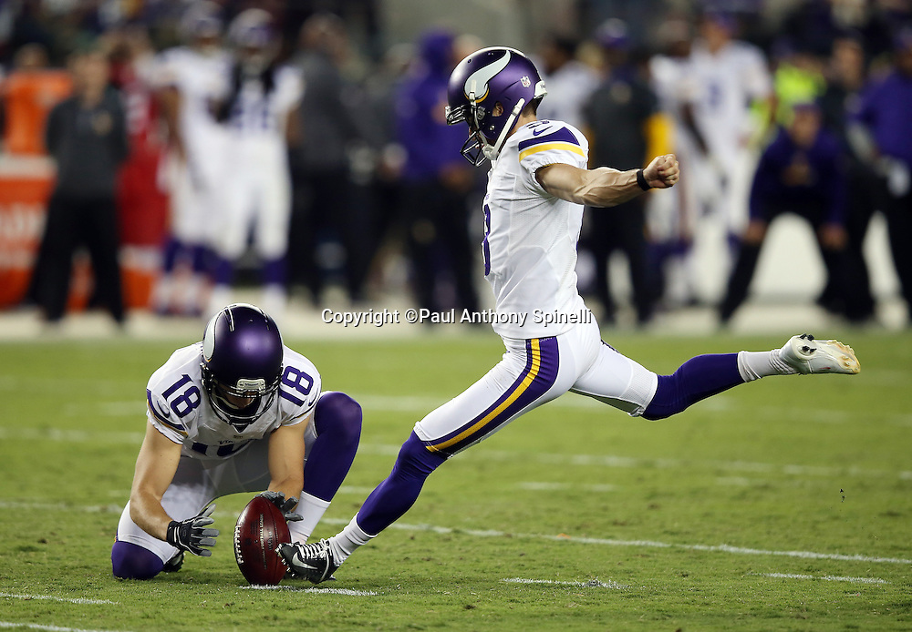 Minnesota Vikings holder and punter Jeff Locke (18) holds while Minnesota Vikings kicker Blair Walsh (3) kicks a 37 yard fourth quarter field goal that cuts the San Francisco 49ers lead to 10-3 and avoid a shutout during the 2015 NFL week 1 regular season football game against the San Francisco 49ers on Monday, Sept. 14, 2015 in Santa Clara, Calif. The 49ers won the game 20-3. (©Paul Anthony Spinelli)