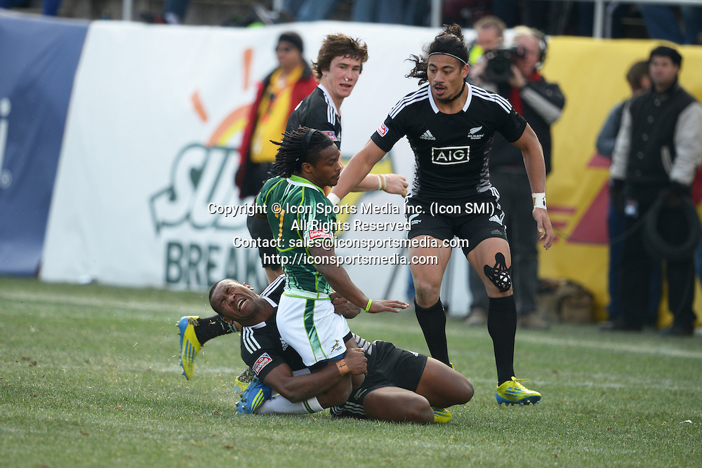 10 February 2013: Branco du Preez (7) of South Africa gets taken down by David Raikuna (9) of New Zealand in the Cup final of round 5 of the HSBC Sevens World Series of Rugby at Sam Boyd Stadium in Las Vegas, Nevada. South Africa defeated New Zealand 40-21.