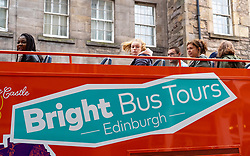 Edinburgh, Scotland, UK. 28 July, 2020. Business and tourism slowly returning to the shops and streets of Edinburgh city centre. Tourists on a city bus tour in the Old Town . The numbers of tourists is increasing but are still far fewer than normal for the summer season. Iain Masterton/Alamy Live News