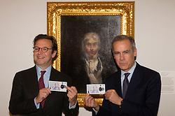© Licensed to London News Pictures. 20/02/2020. London, UK.  Director of Tate Britain Alex Farquharson(L) and Bank of England Governor Mark Carney(R) poses with the new £20 banknote in front of a JMW Turner's self-portrait painting, which features on the note. Photo credit: Ray Tang/LNP