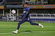 AFC Wimbledon goalkeeper Nathan Trott (1) kicking a ball warming up during the Leasing.com EFL Trophy match between AFC Wimbledon and Leyton Orient at the Cherry Red Records Stadium, Kingston, England on 8 October 2019.