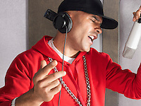Young man singing in studio portrait