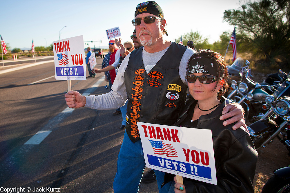 30 MAY 2011 - PHOENIX, AZ: JERRY STUTLER and CARMEL WEAVER stand to honor American veterans before Memorial Day services in the National Memorial Cemetery in Phoenix, AZ, Monday. Memorial Day was celebrated with services across the United States Monday.    Photo by Jack Kurtz