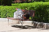 people relaxing in jardines de sabatini madrid, spain