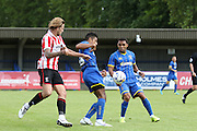 Lyle Taylor & Andy Barcham during the Pre-Season Friendly match between AFC Wimbledon and Cheltenham Town at the Cherry Red Records Stadium, Kingston, England on 1 August 2015. Photo by Stuart Butcher.