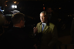 """© London News Pictures. """"Looking for Nigel"""". A body of work by photographer Mary Turner, studying UKIP leader Nigel Farage and his followers throughout the 2015 election campaign. PICTURE SHOWS - Nigel Farage speaks to the media as her arrives at the Walpole Bay Hotel in Margate, as it became apparent in the final hours of My 7th that his party had not achieved their goals in the General Election, with only Douglas Carswell being elected MP and Mr Farage failing to win his own seat. . Photo credit: Mary Turner/LNP **PLEASE CALL TO ARRANGE FEE** **More images available on request**"""