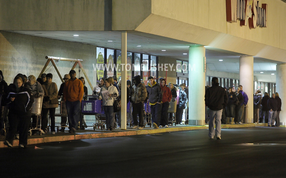 Town of Wallkill, New York - People wait in line to get into a Toy R Us store on Thanksgiving night to get an early start on their Black Friday shopping on Nov. 25, 2010. The toy store opened at 10 p.m. The store the people are standing in front of did not open until Friday morning.