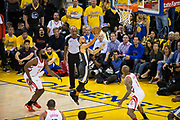 Golden State Warriors guard Stephen Curry (30) lays the ball into the basket against the Houston Rockets during Game 4 of the Western Conference Finals at Oracle Arena in Oakland, Calif., on May 22, 2018. (Stan Olszewski/Special to S.F. Examiner)