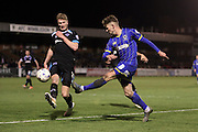 AFC Wimbledon midfielder Jake Reeves (8) crosses the ball during the Sky Bet League 2 match between AFC Wimbledon and Portsmouth at the Cherry Red Records Stadium, Kingston, England on 26 April 2016.