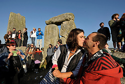 © Licensed to London News Pictures. 21/06/2014; Amesbury, WIltshire, UK.  Rachel and Andrew Rider renew their marriage vows as thousands of people welcome the solstice on the longest day at Stonehenge.<br /> Photo credit: Simon Chapman/LNP