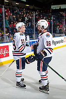 KELOWNA, BC - OCTOBER 12: Team captain Zane Franklin #16 shakes hands with Orrin Centazzo #19 of the Kamloops Blazers after the win against the Kelowna Rockets at Prospera Place on October 12, 2019 in Kelowna, Canada. (Photo by Marissa Baecker/Shoot the Breeze)