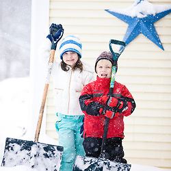 A brother and sister shovel snow during a snowstorm in Portsmouth, New Hampshire.
