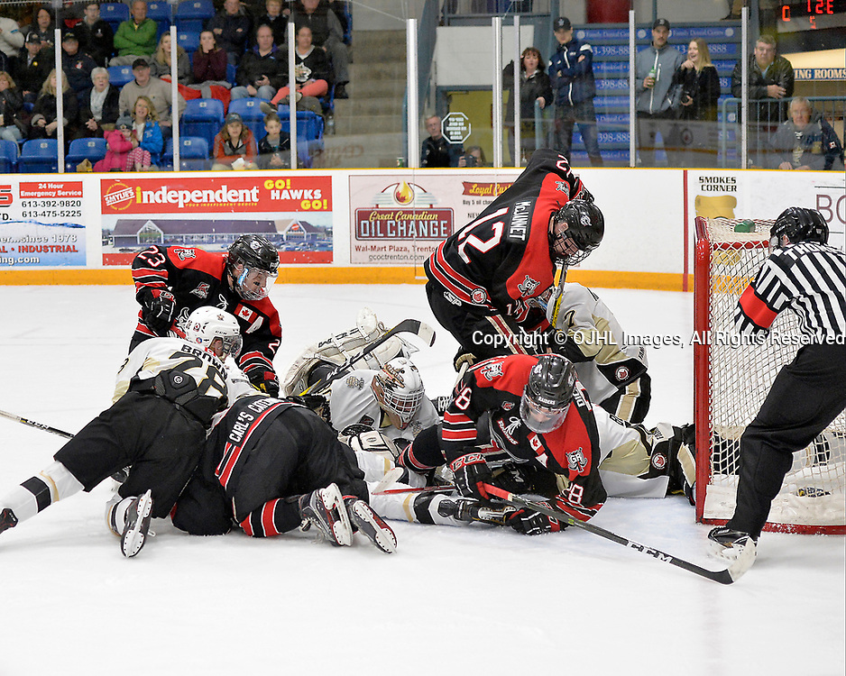 TRENTON, ON  - APR 15,  2017: Ontario Junior Hockey League, Championship Series.  Georgetown Raiders vs the Trenton Golden Hawks in Game 2 of the Buckland Cup Final.   Players from both teams scramble to get to the loose puck during the second period.<br /> (Photo by Shawn Muir / OJHL Images)