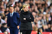 Wales Women's manager Jayne Ludlow with England women's manager Phil Neville behind during the FIFA Women's World Cup UEFA Qualifier match between England Ladies and Wales Women at the St Mary's Stadium, Southampton, England on 6 April 2018. Picture by Graham Hunt.