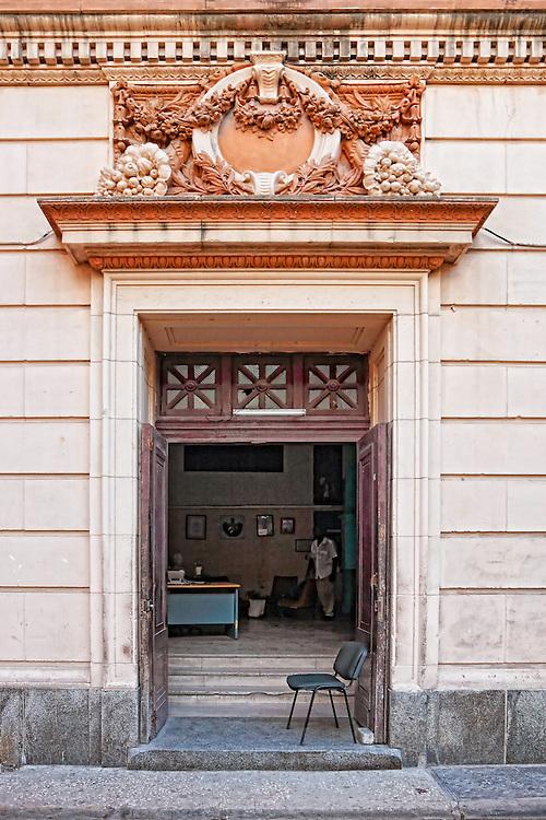 Grand surround on office door in Havana Vieja, Cuba.