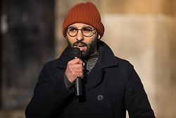 London, UK. 30 November, 2019. Salah Faissal, an independent candidate, speaks at a general election hustings for the Vauxhall constituency outside St Mark's church. Topics discussed included the lack of social housing provision, knife crime, the suitability of the candidates to be Prime Minister and airport expansion.